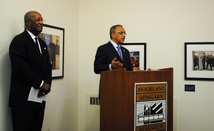 President Sidney A. Ribeau gives remarks as Howard Dodson, Director of Moorland-Spingarn Research Center, presents the exhibit opening.